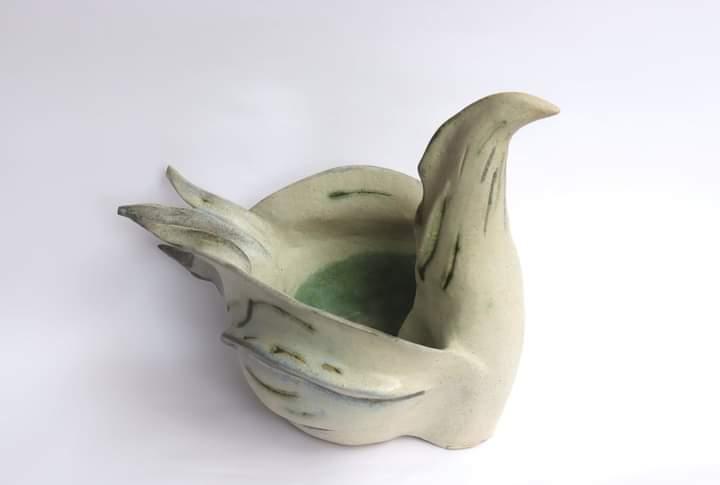 Bird pot sculpture.