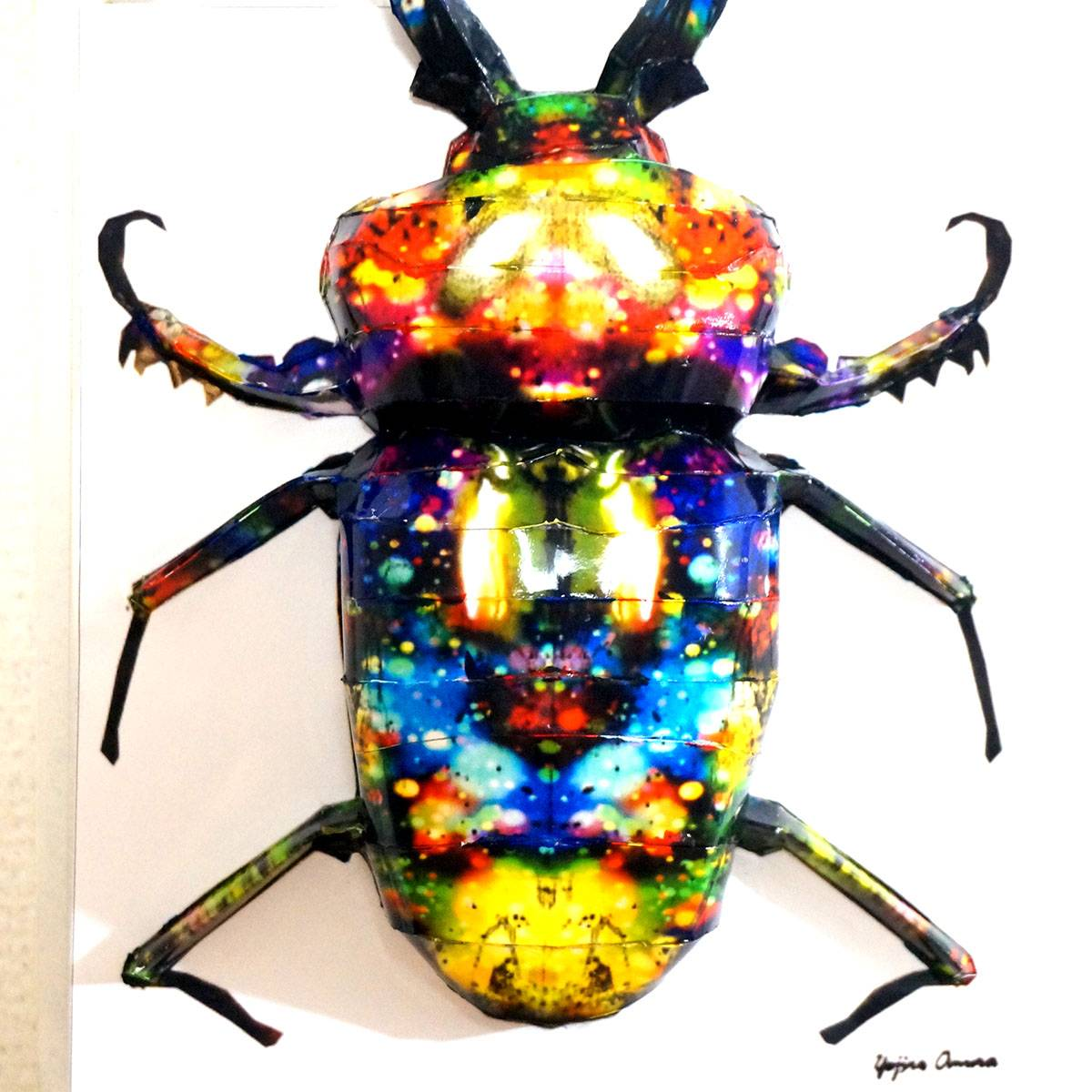 The glittering stag beetle overhangs the panel ED:4/10