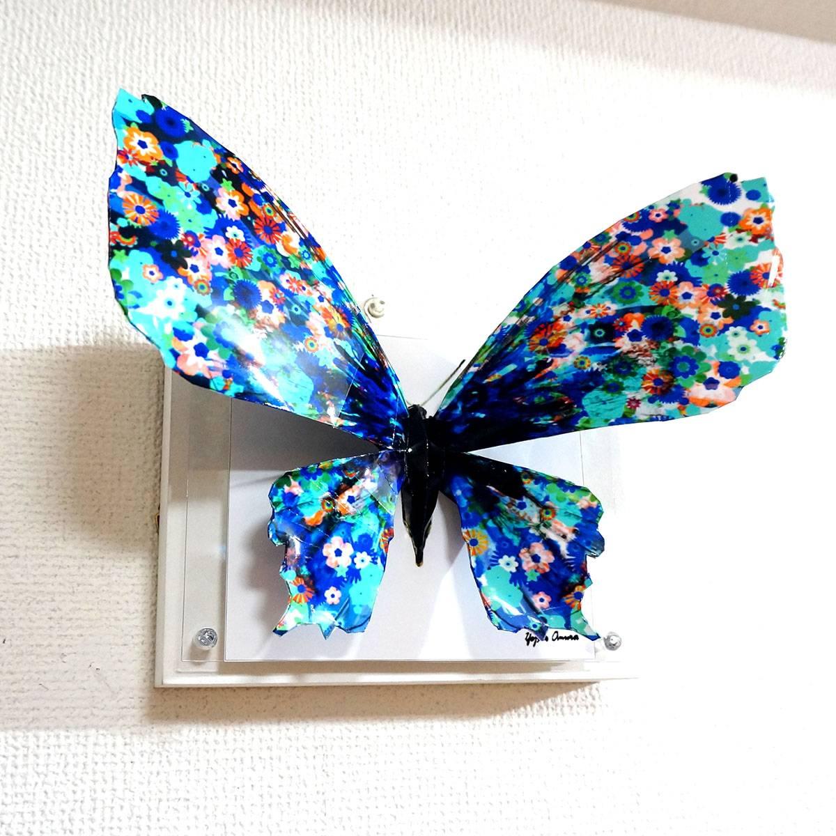The blue flower butterfly spreads its wings ED:4/10