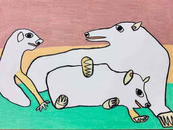 Three white bears (polar bears) resting on an ice floe