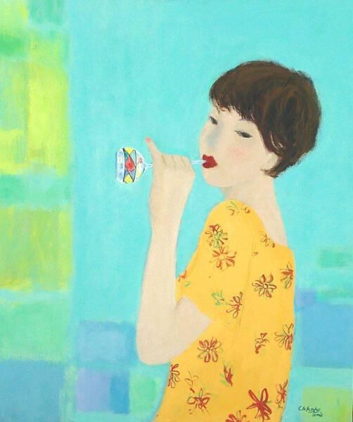 A Women Blowing a Glass