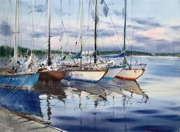 Moored yachts at sunset