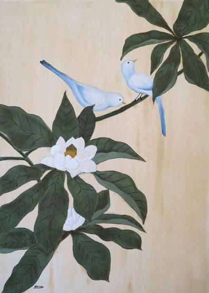 Birds on magnolia tree